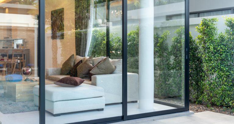 open plan living area with sliding door and garden